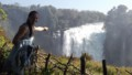 person pointing t Victoria Falls