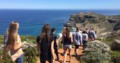 people Walking along the Cape Point Coast