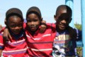 3 young boys smiling