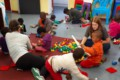 children and volunteers playing together