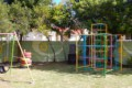 garden with swing and climbing frame