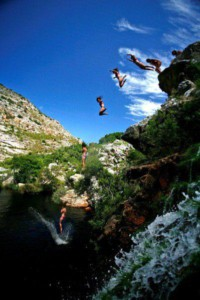 Person cliff diving at crystal pools