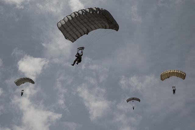 people skydiving
