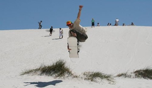 man jumping with sandboard