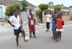 kids playing soccer in township