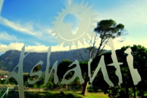 Ashanti logo on window with view of Table Mountain Ashanti Gardens Backpackers Cape Town