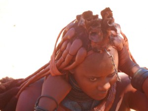 A himba tribe girl doing her hair