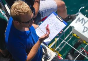 man studying shark dorsal fin