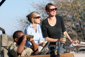 people and guide on game drive
