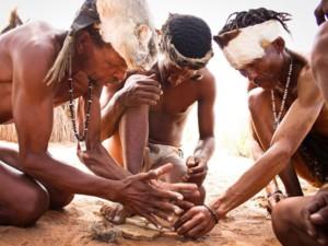 Khomani San men making fire
