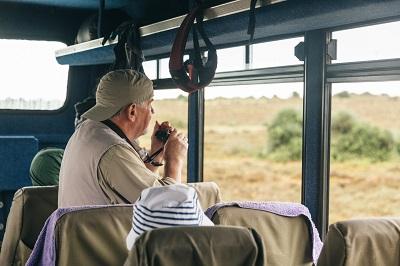 man at window overland truck