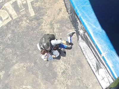 people jumping out of a plane