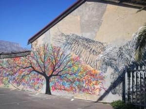 street art of a tree and a bird